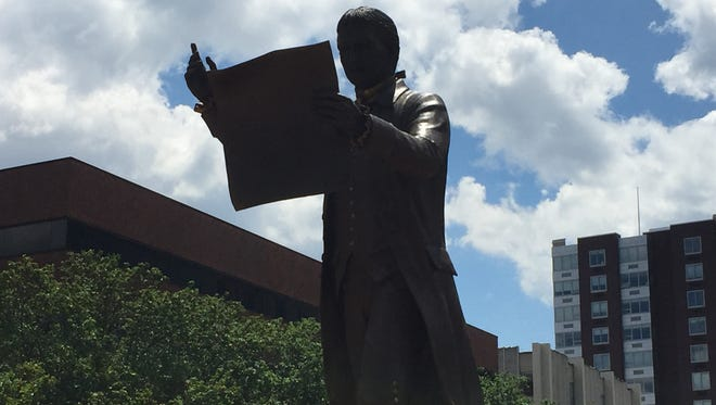 "On July 9, 2017, the 241st anniversary of the third reading of the Declaration of Independence by Col. John Neilson, the New Brunswick Public Sculpture Committee dedicated their inaugural commission — a depiction of that moment in history. ""The Third Reading of the Declaration of Independence"" stands at Monument Square on the corner of George Street and Livingston Avenue in New Brunswick."