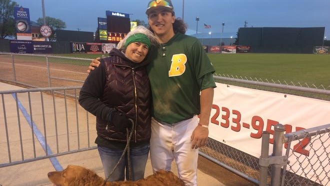 North Dakota State baseball star Jayse McLean poses with his mother, Josy, and the family dog, Jakoby. McLean earned Academic All-American honors this spring.