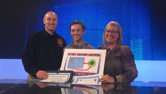 Cumberland County Technical Education Center student Cameron Ippolito (center) won a state Division of Fire Safety poster contest. Pictured here with Cumberland County Fire Marshal Rob Strain (left) and CCTEC digital arts instructor Lauren Hawk.