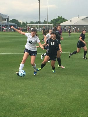Montgomery Academy's Cari Budny battles for the ball against Holy Spirit in the Class 1A-3A state soccer semifinals in Huntsville