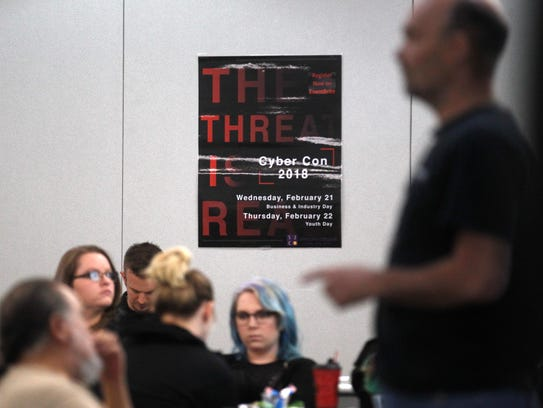 Participants in the third annual CyberCon event at San Juan College in Farmington listen to an address by keynote speaker Richard Hammer  on Wednesday.