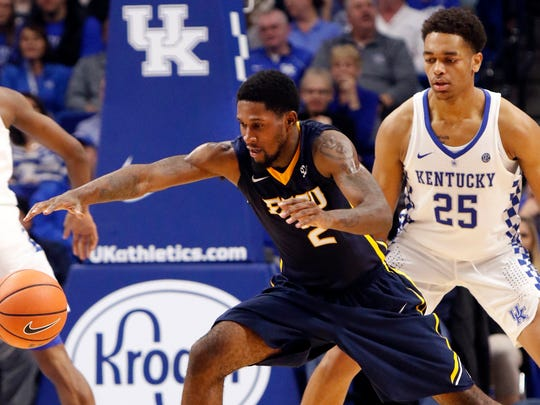 East Tennessee State's David Burrell (2) pulls in the ball as Kentucky's P.J. Washington (25) defends during the second half of an NCAA college basketball game, Friday, Nov. 17, 2017, in Lexington, Ky. (AP Photo/James Crisp)