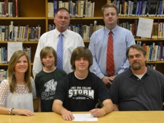 Pictured front row, from left: mother Michele Mitchell, brother Evan Mitchell, Jacob Mitchell and father Matthew Mitchell. Back row, from left: Dallastown athletic director Tory Harvey and coach Chris Andrews.