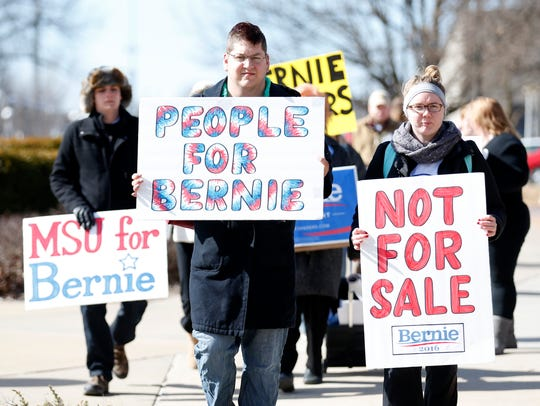 Missouri State students carry Bernie Sanders signs