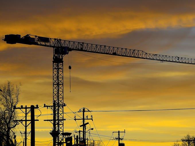 Construction cranes dot Nashville's skyline.