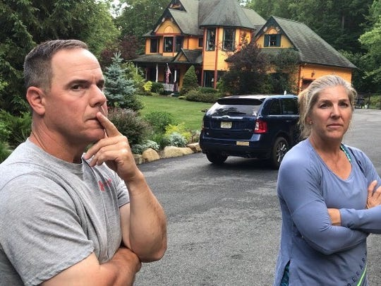 Dave and Karen Fierro, in the driveway of their Bloomingdale