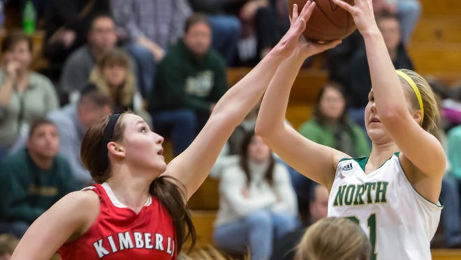 Kimberly's Frankie Wurtz (left) attempts to block the shot of Oshkosh North's Alexis Hansen's during a Fox Valley Association matchup Dec. 5 at Oshkosh North,