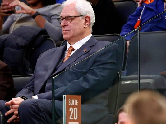 FILE- In this Jan. 9, 2017 file photo, New York Knicks president Phil Jackson watches from the stands during the second half of an NBA basketball game against the New Orleans Pelicans at Madison Square Garden in New York. Jackson may be trying to trade Carmelo Anthony because he's given up trying to change him. That seemed to be the conclusion when he broke his Twitter silence with a tweet that was another dig at the star forward. (AP Photo/Kathy Willens, File)