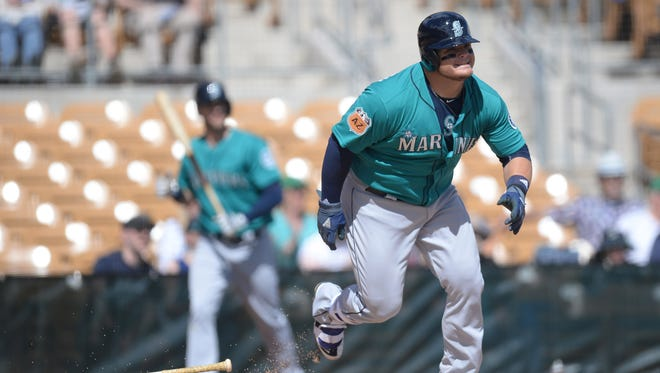 Seattle Mariners first baseman Dan Vogelbach  runs after hitting a single against the Chicago White Sox in the second inning at Camelback Ranch.