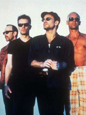 Members of the rock group U2 pose for a studio portrait in April 1997. From left, are: guitarist Edge, drummer Larry Mullen, lead vocalist Bono and bass player Adam Clayton.