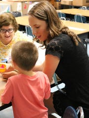 Paraprofessionals Catherine Reo (left) and Catherine Sabatino work with early elementary students during the Extended School Year Program in Westfield Public Schools.