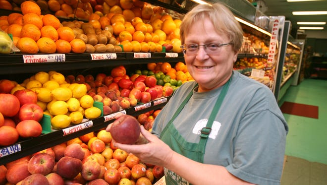 Linda Concklin, daughter of one of Rockland's first farming families who championed a 300-year-old tradition, died Dec. 3 at 67. She is seen here in 2012, holding one of the farm's Winesap apples for sale in the store at The Orchards of Concklin in Ramapo.