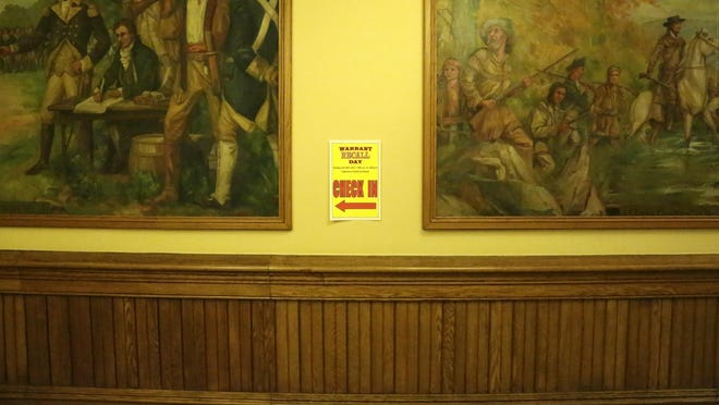 A sign on the wall inside the Tippecanoe County Courthouse directs defendants to the check-in area for a warrant recall event Tuesday, June 30.