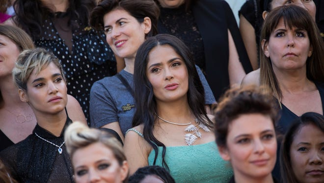 Sofia Boutella, Salma Hayek and Patty Jenkins stand as part of 82 women marching for parity in Cannes on Saturday.
