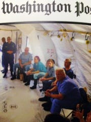 Paul Nordstrom (foreground in blue) is shown in a picture on the Washington Post website last fall as the lead nurse of a team of Americans fighting Ebola in West Africa.