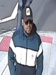 Surveillance photo of a robbery suspect. Police say he robbed a Paterson Western Union office at gunpoint.