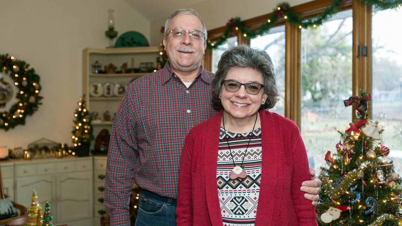 Retirees from Iowa, Lynn and Pat Schooley talk about their house near Table Rock Lake.