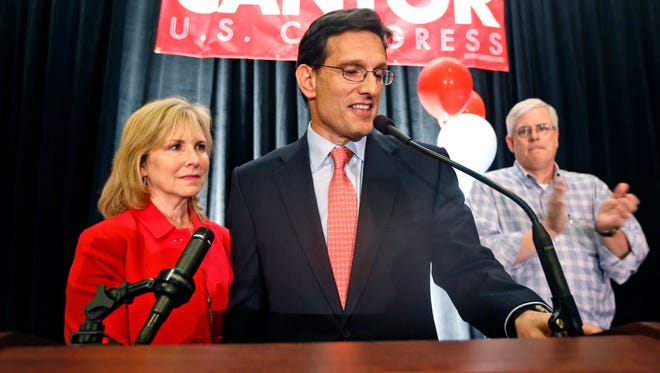 House Majority Leader Eric Cantor, R-Va.,  stands beside his wife, Diana, left,  and delivers a concession speech at his election night party in Richmond, Va., on June 10, 2014.