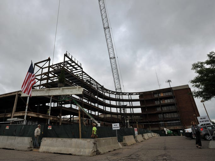 The final beam is lifted in to place for the Fairfield Medical Center expansion Monday, July 28, 2014, in Lancaster.