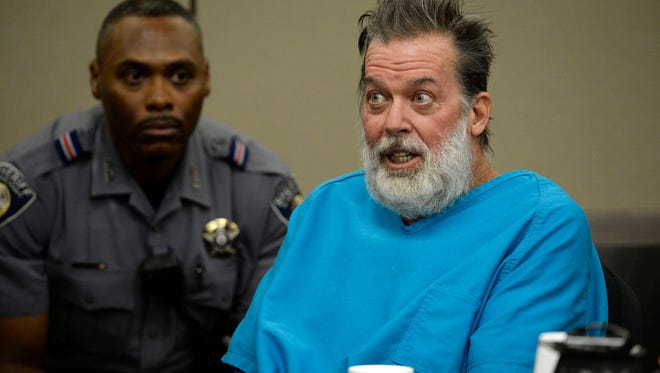 Robert Dear talks to Judge Gilbert Martinez during a court appearance in Colorado Springs, Colo., on Dec. 9, 2015.