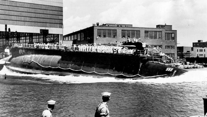 In this July 9, 1960, file photo the nuclear-powered attack submarine USS Thresher, a first in its class boat, is launched at Portsmouth Naval Shipyard.