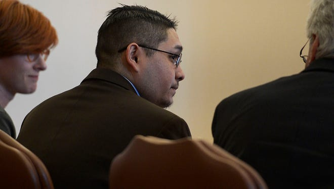 Defendant Juan Canales-Hernandez, center, briefly looks up after the jury declared him guilty of first degree murder on Tuesday, April 3, 2018, at the Larimer County Justice Center in Fort Collins, Colo.
