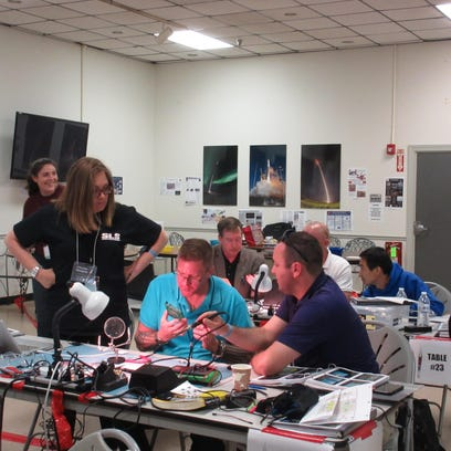 The UW-Sheboygan Rock On Team works on assembly and soldering parts of rocket payload. Pictured, from left, is Wisconsin Space Grant Consortium Program Manager Kristine Thompson, UW-Sheboygan student Ryan Kisiolek and UW-Sheboygan astronomy professor William Dirienzo.