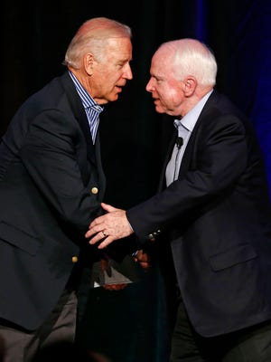 Vice President Joe Biden and Senator John McCain, R-Ariz., shake-hands and hug after their conversation at the McCain Institute for International Leadership's 2013 Sedona Forum on Friday, April 26, 2013 at the Enchantment Resort in Sedona, AZ. The institute focuses on foreign-policy and national-security issues. Photo by Rob Schumacher/The Arizona Republic (Via OlyDrop)