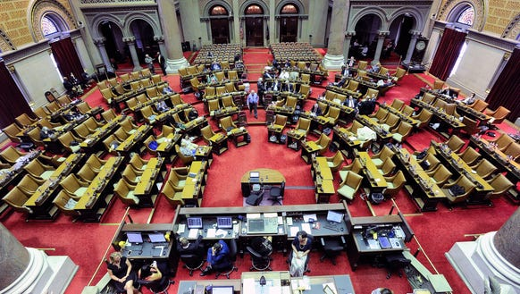 Members of the New York state Assembly stand in the