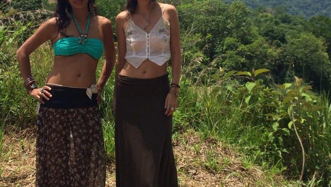 Raela and Emmalee Sutton pose by the water in Dominical, Costa Rica, last year during their first trip last year.