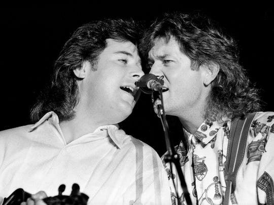 """Vince Gill, left, and Rodney Crowell perform the Harlan Howard tune """"Excuse Me, I Think I've Got a Heartache"""" during Howard's fifth annual birthday bash in the Music Row parking lot of BMI on Sept. 9, 1987."""