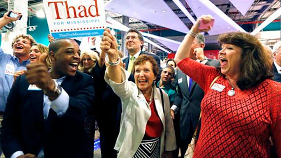 In this June 24, 2014 file photo, supporters of Sen. Thad Cochran, R-Miss., break into cheer as he is declared the winner in his primary runoff for the GOP nomination for U.S. Senate at his victory party at the Mississippi Children's Museum in Jackson, Miss.
