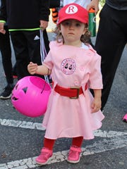 "Lillian Domzalski, 2, is dressed up liked a Rockford Peach baseball player such as in the movie ""A League of Their Own."""