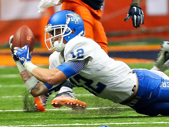 MTSU freshman safety Reed Blankenship dives to intercept a pass against Syracuse at the Carrier Dome on Sept. 9, 2017.