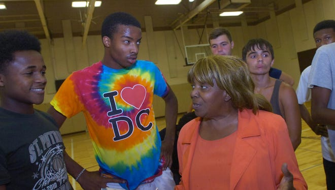 Diane Powell talks with some of the teens who are part of her summer jobs program.