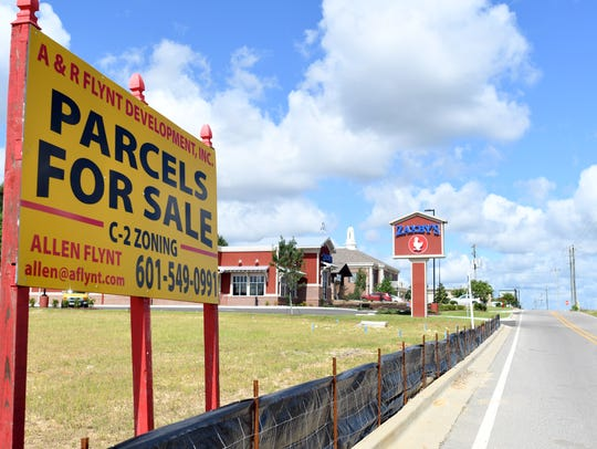 Commercial lots are for sale along Evelyn Gandy Parkway