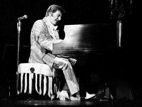 The glittering piano superstar Liberace performs during his television special at the Grand Ole Opry House on Feb. 1, 1978.
