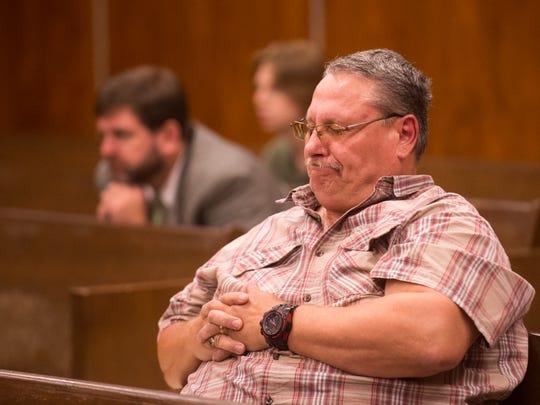 Michael Eldridge reacts as Lee Harold Cromwell is sentenced