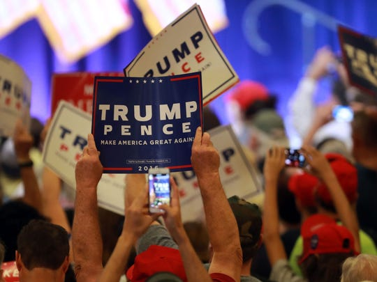 Supporters cheer as Donald Trump unveils his 10-point