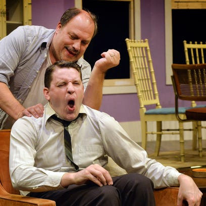 """Oscar, played by Bruce Meahl, rubs the back of roommate Felix (Reed Halvorson) in Centre Stage's """"The Odd Couple,"""" opening Thursday, Sept. 10. Oscar and Felix are great friends but terrible roommates."""