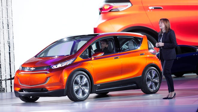 General Motors CEO Mary Barra reveals the new Chevrolet Bolt concept to the media at the 2015 North American International Auto Show