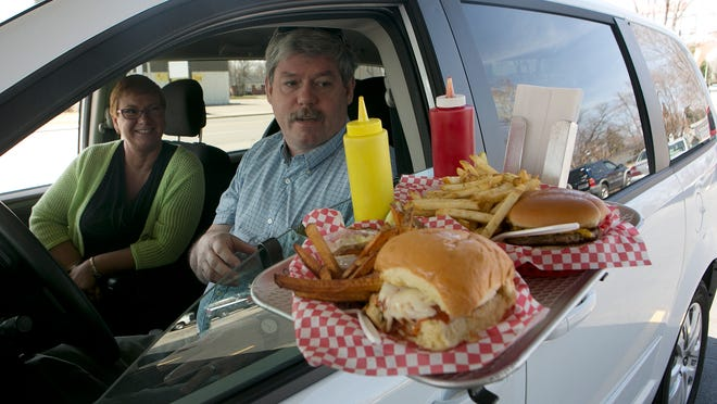 Angela VanGroll of Nekoosa, left, and Mike Fuge of Stevens Point, spend their lunch break at Kathy's Drive Inn in Wisconsin Rapids, Tuesday, April 14, 2015.