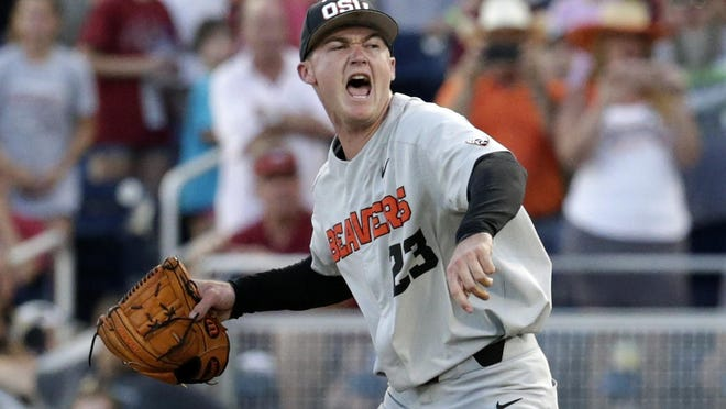 Oregon State pitcher Kevin Abel reacts after he threw a complete game shutout in 5-0 win over Arkansas in Game 3 of the 2018 College World Series finals in Omaha, Neb.