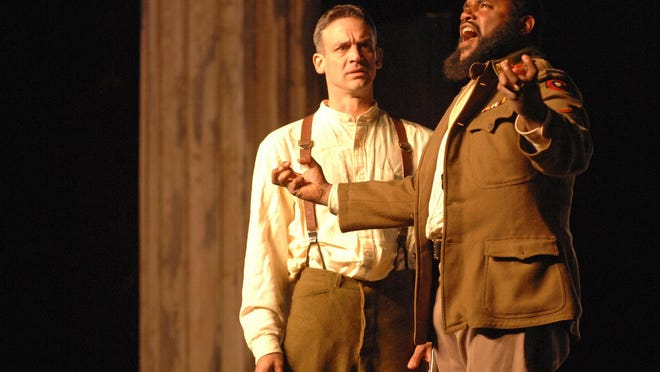 "Othello played by Kes Khemnu is enraged when told by Iago, left, played by Mark Niebuhr of Desdemona's infidelity during the Savannah Shakespeare Festival's production of ""Othello"" in Forsyth Park in 2006."