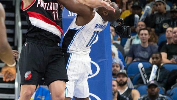 Portland Trail Blazers forward Meyers Leonard (11) fouls Orlando Magic center Bismack Biyombo (11) on a shot during the second half of an NBA basketball game in Orlando, Fla., Thursday, Feb. 23, 2017. Portland won 112-103. (AP Photo/Willie J. Allen Jr.)