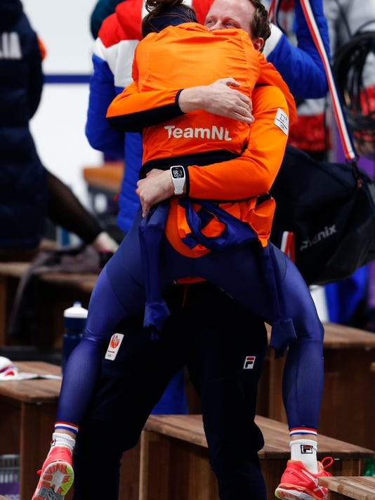 Gold medallist Ireen Wust of Netherlands hugs her coach after the women's 1,500 meters speedskating race at the Gangneung Oval at the 2018 Winter Olympics in Gangneung, South Korea, Monday, Feb. 12, 2018. (AP Photo/John Locher)
