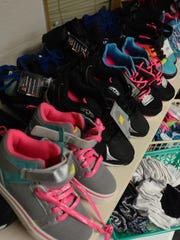 A Community Sharing benefactor donated dozens of pairs of brand new shoes for kids going back to school.