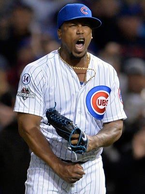 Chicago Cubs relief pitcher Pedro Strop reacts as the Cubs' first baseman Anthony Rizzo (44) tags out St. Louis Cardinals' Kolten Wong (16) during the eighth inning of Game 4 in baseball's National League Division Series Tuesday in Chicago.