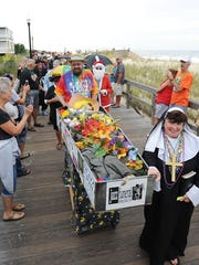 Summer 2016 being carried down the Bethany Beach Boardwalk