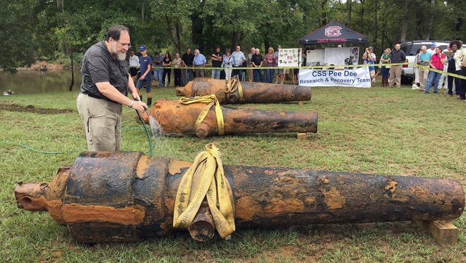 University of South Carolina archaeologist and state archaeologist Jon Leader washes and inspects one of the three Civil War cannons pulled from the Pee Dee River on Tuesday, Sept. 29, in Mars Bluff, S.C. The three cannons were dumped in the river by Confederate forces from the gunboat CSS Pee Dee in 1865 in order to keep them from falling into the hands of Union forces.